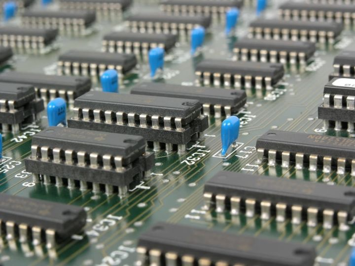 close up photo of a computer chip motherboard