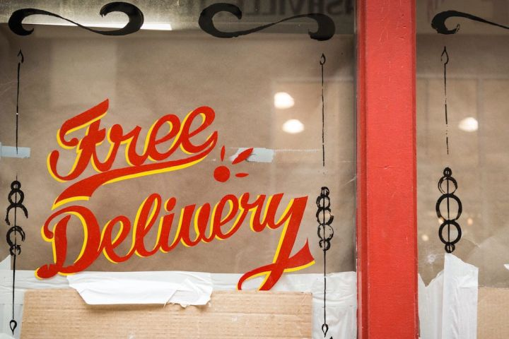 Photo of a window sign saying 'free delivery'