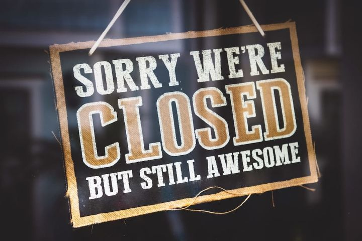 Photo of a 'closed but still awesome' sign on a storefront as a metaphor for retiring crowdfilings.com website