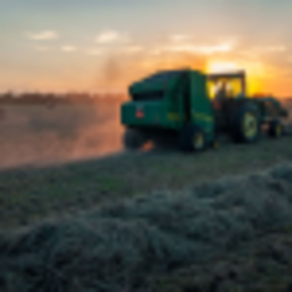 Photo of a tractor working a field at sunset to accompany post about interview with Artem Milinchuk of FarmTogether