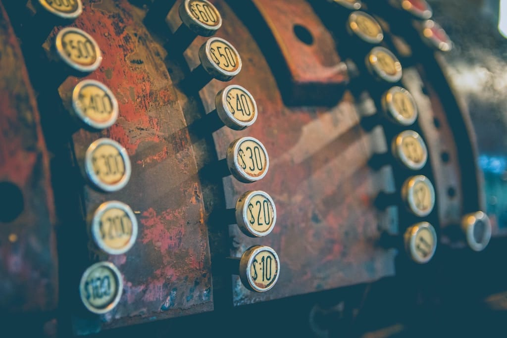 close up photo of an antique cash register