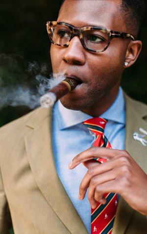 Man in suit smoking cigar