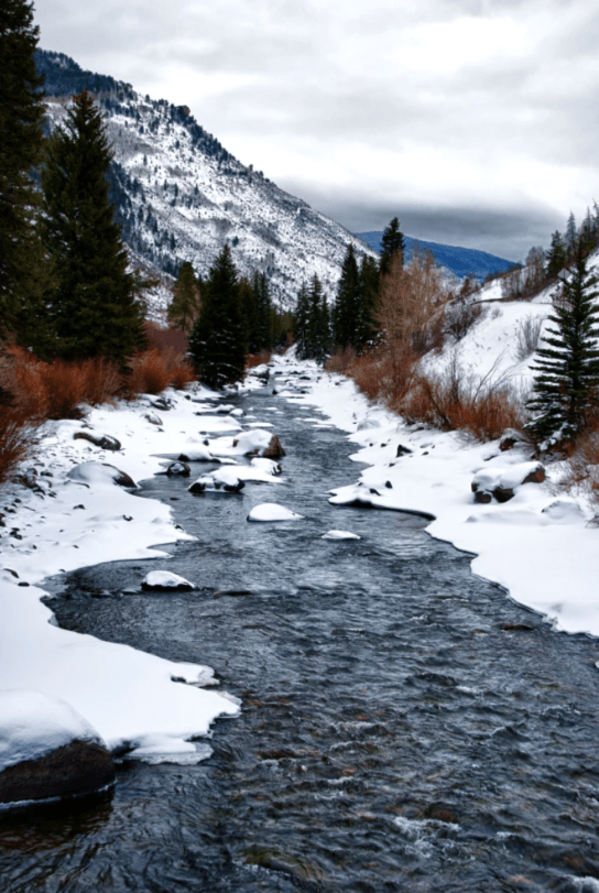 Beaver Creek colorado stream in snowy mountains