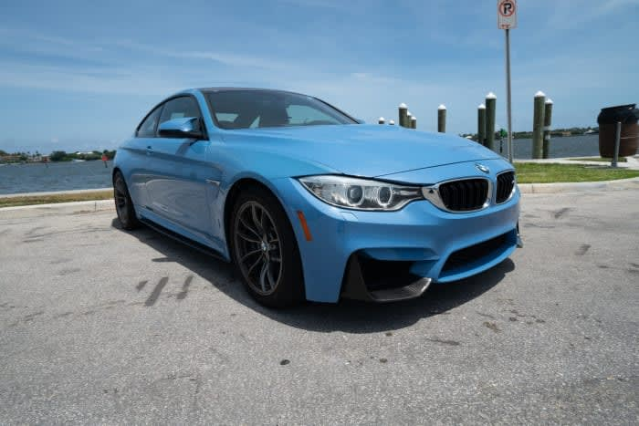 Featured Product: 2015 BMW M4 Manual Transmission Yas Marina Blue For Rent In Miami Fort Lauderdale Palm Beach South Florida