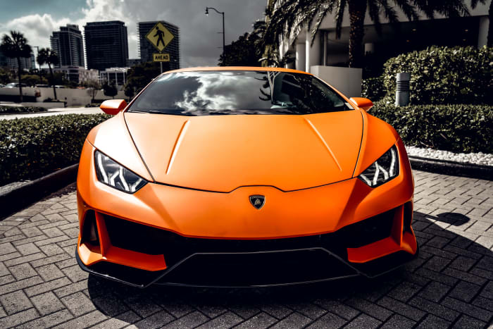 Image #0 of our 2018 Lamborghini Huracan EVO Spyder (Matte Orange) In Miami Fort Lauderdale Palm Beach South Florida