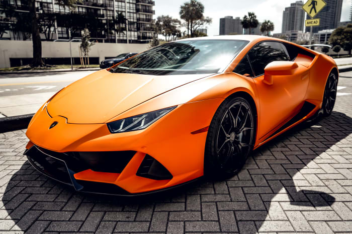 Image #3 of our 2018 Lamborghini Huracan EVO Spyder (Matte Orange) In Miami Fort Lauderdale Palm Beach South Florida