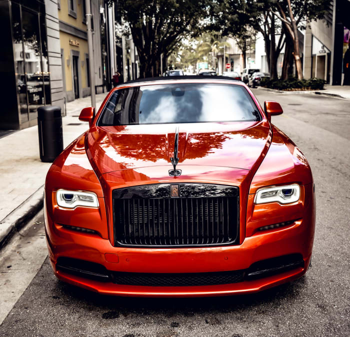 Image #1 of our 2021 Rolls Royce Dawn Black Badge (Orange) In Miami Fort Lauderdale Palm Beach South Florida