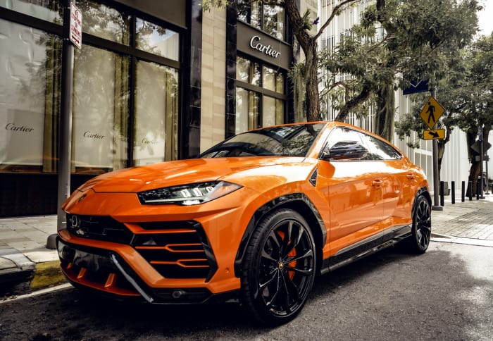Image #0 of our 2021 Lamborghini Urus Starlight (Orange) In Miami Fort Lauderdale Palm Beach South Florida