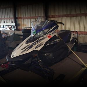 2010 Yamaha Apex snowmobile, with tilt-bed trailer