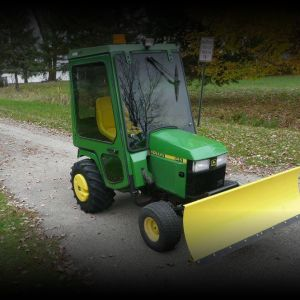 John Deere 445 Tractor with Heated Cab and Snow Blade