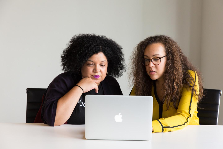 Photography of women using laptop 1181684