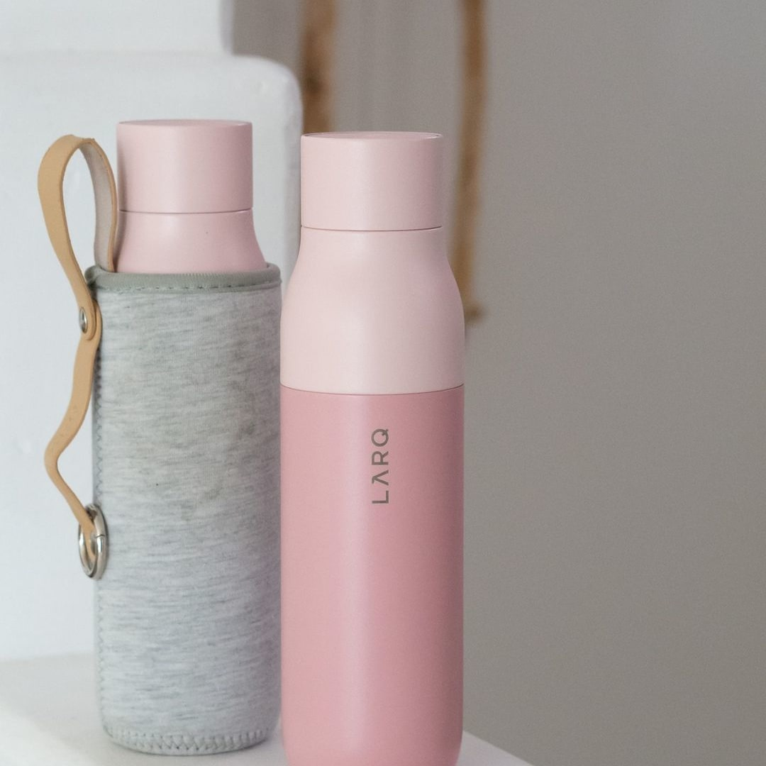 Photo of LARQ Bottle PureVis - Himalayan Pink in Travel Sleeve on staircase