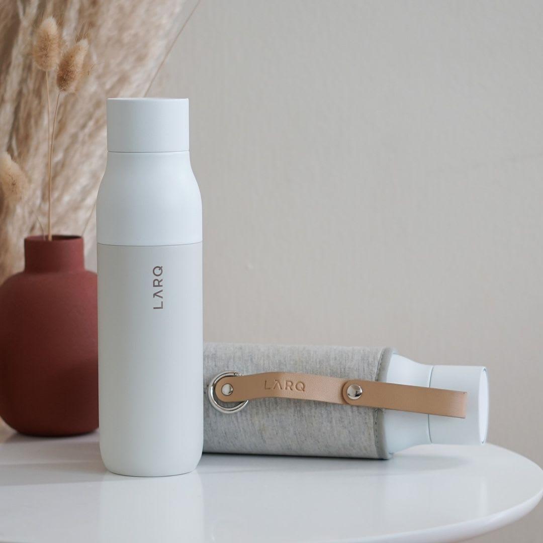 Photo of LARQ Bottle PureVis - Granite White in Travel Sleeve on table