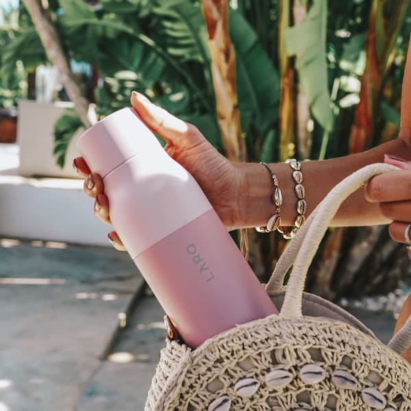 Photo of Larq Bottle PureVis - Himalayan Pink in hands