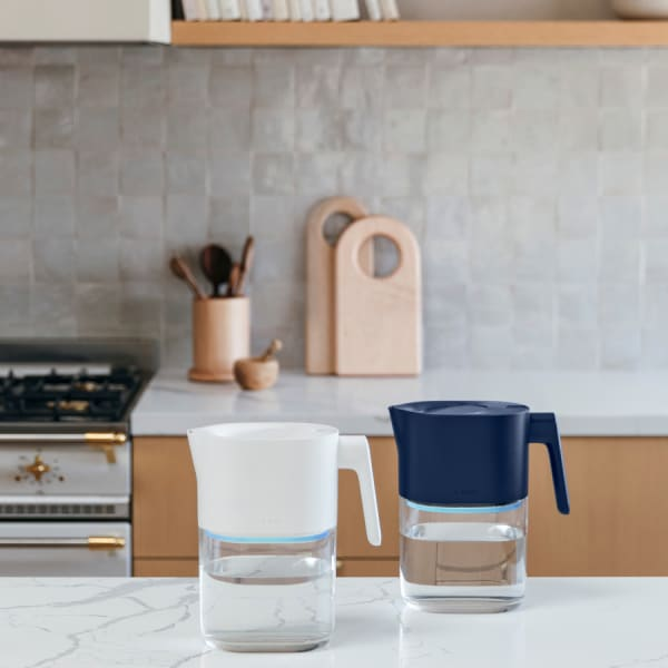 Photo of Larq Pitcher PureVis - Monaco Blue & Pure White on a kitchen counter