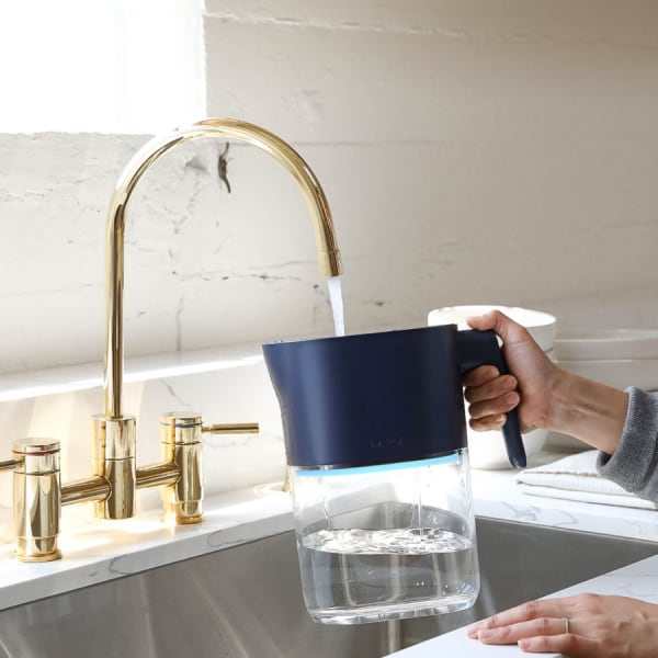 Photo of Larq Pitcher PureVis - Monaco Blue under a kitchen water tap