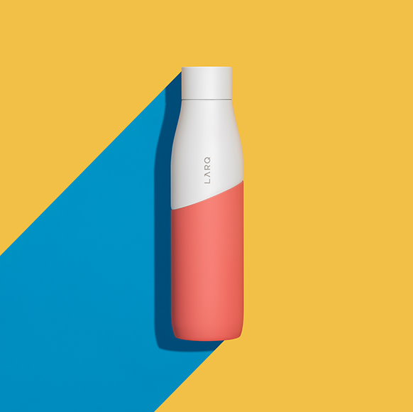 LARQ Bottle PureVis in White/Coral color and size of 32oz/950ml on a yellow and blue background