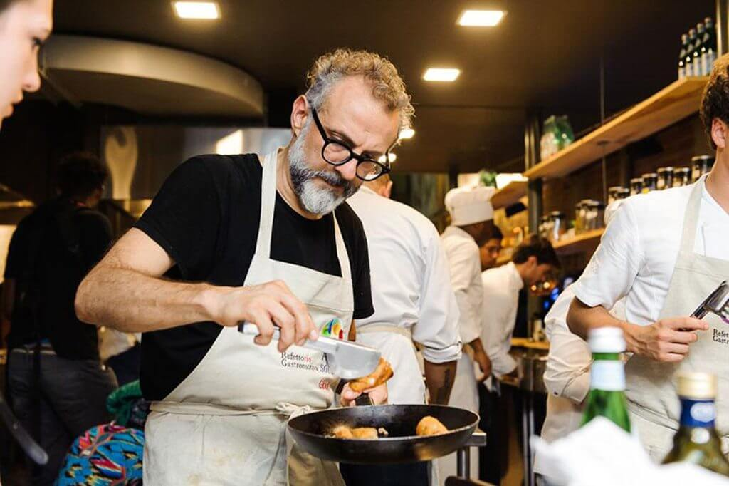 massimo bottura - italian michelin star chef cooking in food for soul kitchen