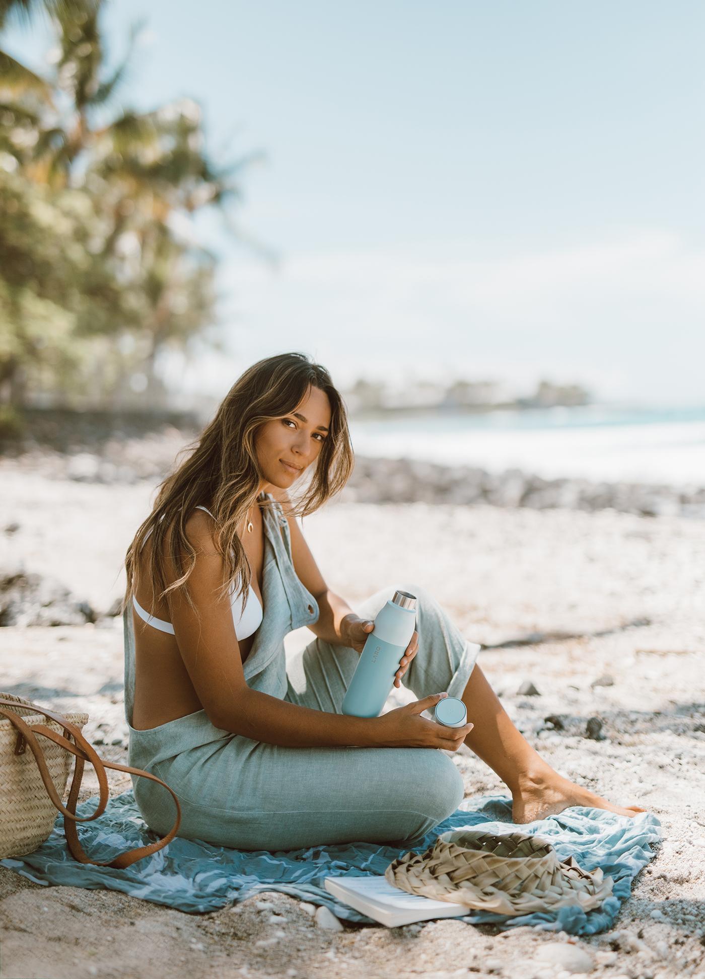 Elana Jadallah holding seaside mint LARQ Bottle on the beach in hawaii