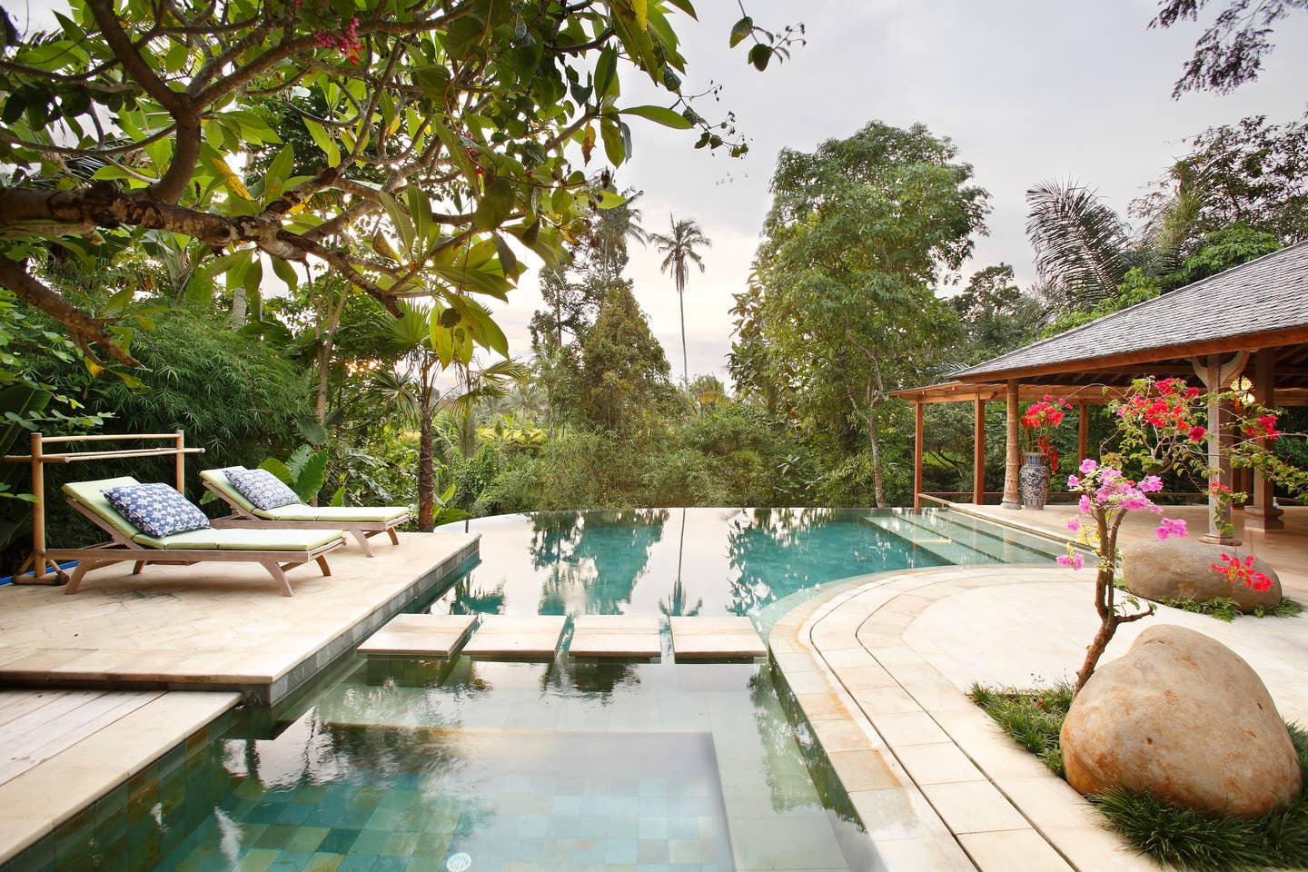 earth house villa in ubud, indonesia with outdoor pool and tropical view