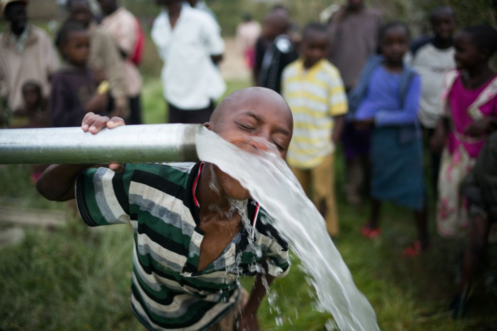 Boy in Ndabibi, Kenya drinking clean water from a newly built Well Aware Pump