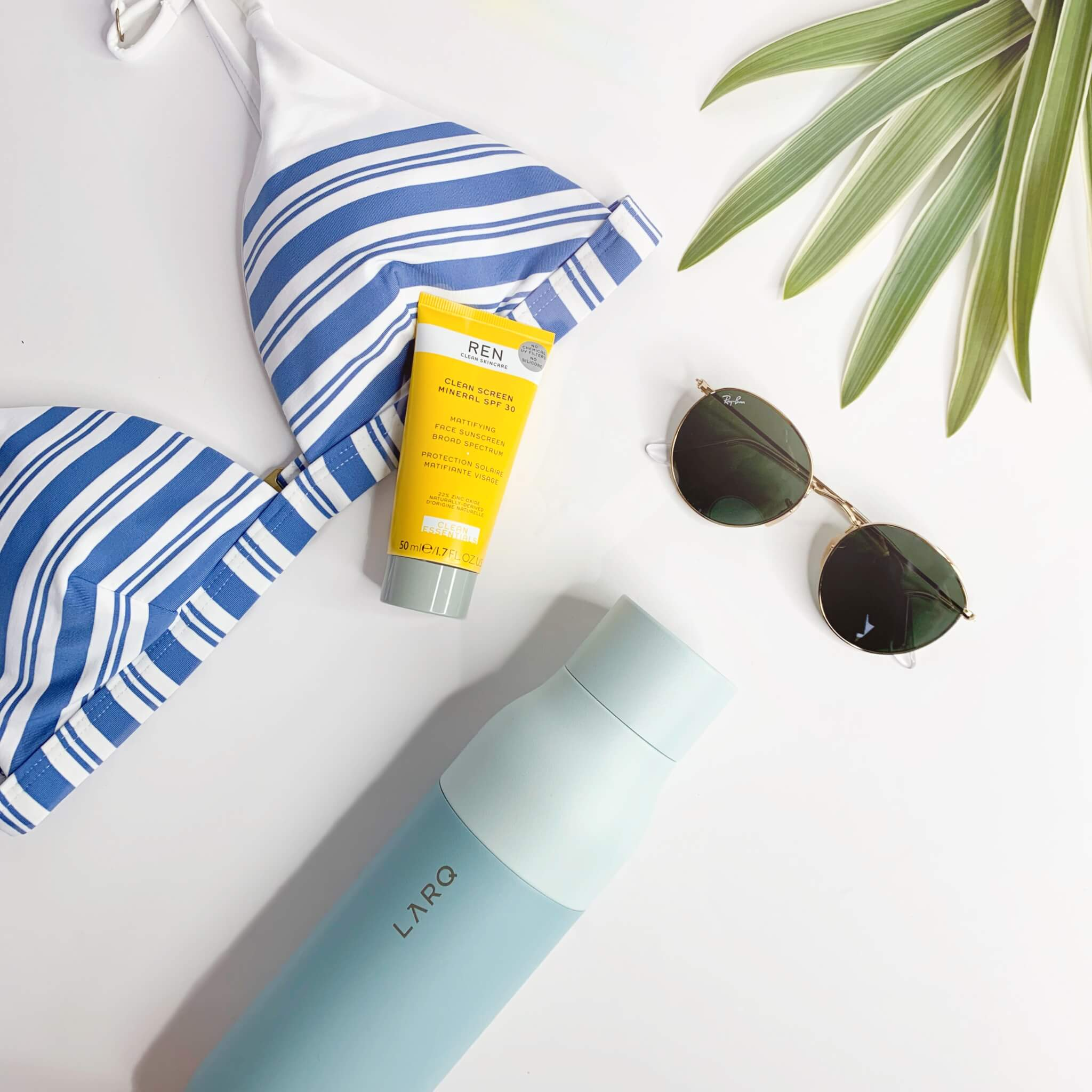 Seaside Mint LARQ Bottle with Vitamin A swimsuit and REN skincare mineral reef-safe sunscreen