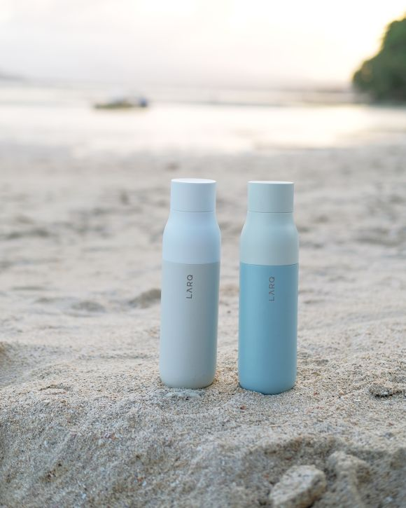 LARQ Bottles at the beach - Pictured in Granite White and Seaside Mint color combinations