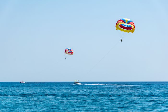 Rhodes, Greece. Try parasailing over the ocean for a bird's eye view