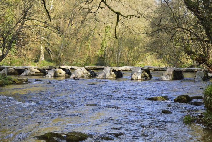 Minehead, Somerset. Walk over the Tarr Steps bridge across River Barle