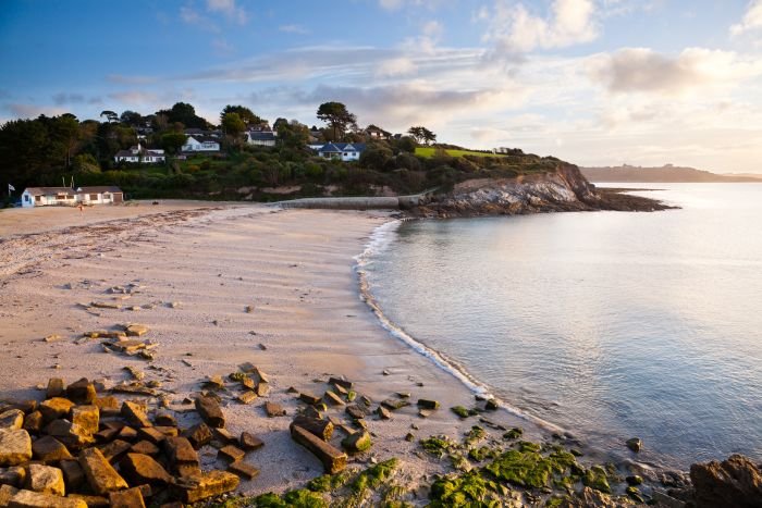 Falmouth, England. Work up an appetite with a coastal walk, then dine at a cafe on Gylly beach