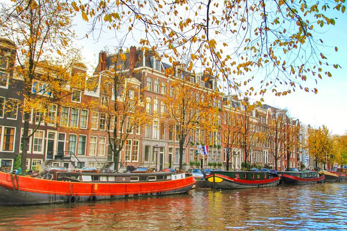 Amsterdam, Netherlands. See the leaves gently fall while sitting at cosy canalside cafes