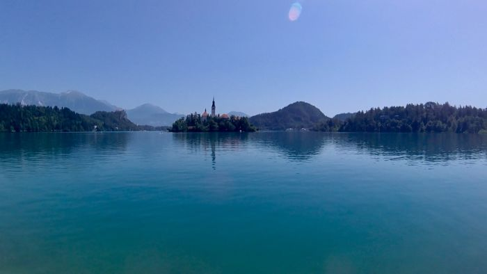 Ljubljana, Slovenia. Take a boat to the island on Lake Bled and explore castles and caves