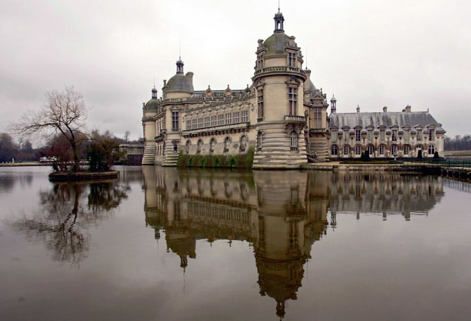 The Chantilly castle is reflected in a pond in Chantilly, France, 50 km North of Paris, Friday Feb. 11 2005. Soccer star Ronaldo is to wed in this castle on Valentine's day. (AP Photo/Jerome Delay)