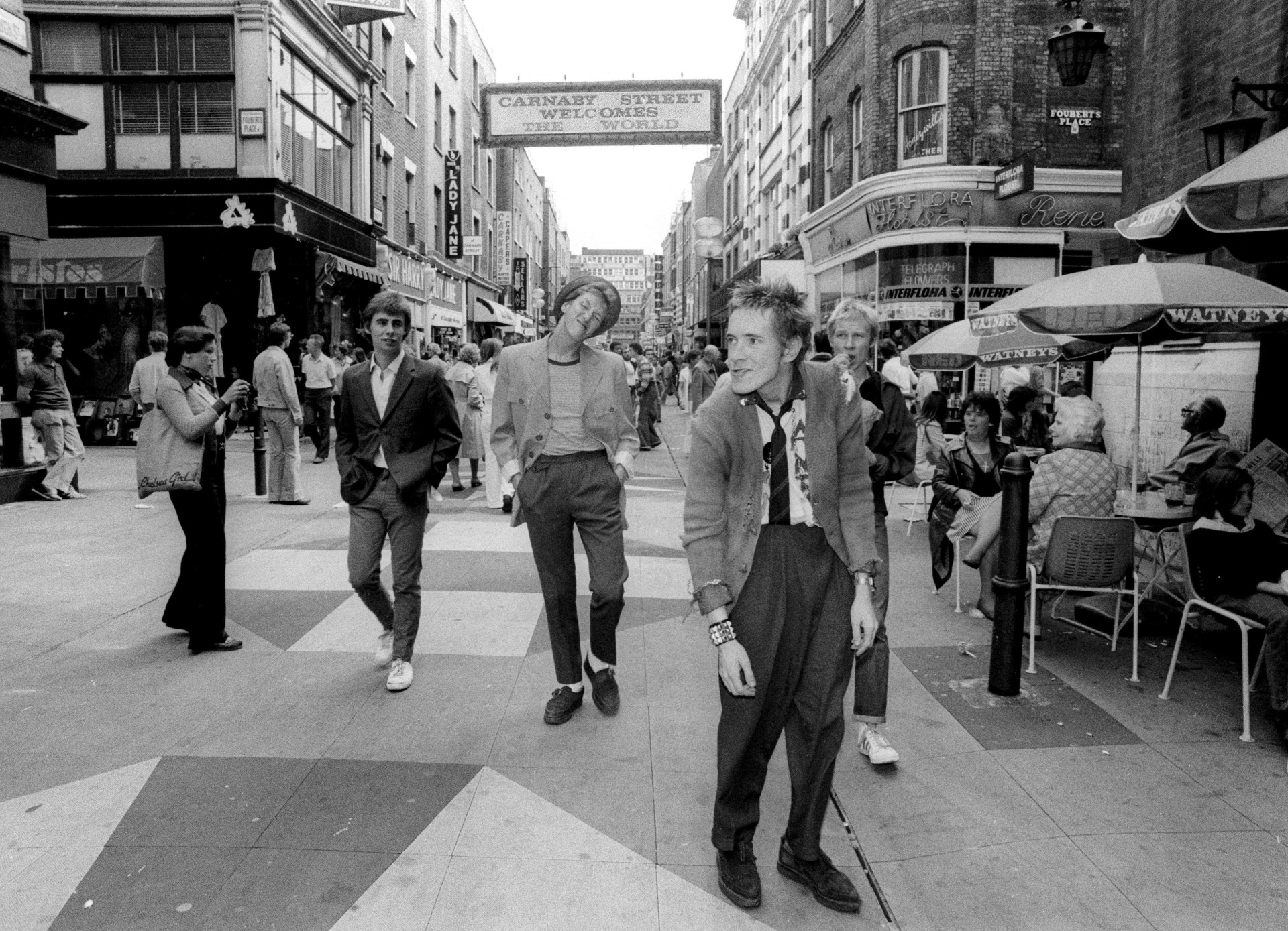 Photo by Ray Stevenson / Rex Features. Sex Pistols - Glen Matlock, Steve Jones, Johnny Rotten and Paul Cook, Carnaby Street. 1976