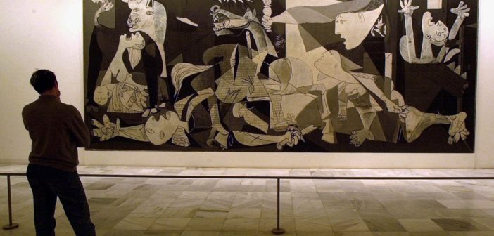 """CAUDRO DEL PINTOR PICASSO ''EL GUERNICA'' EN MUSEO REINA SOFIA DE MADRID *** Local Caption *** A person views Spanish artist Pablo Picasso's world famous painting """"Guernica"""" at Madrid's Reina Sofia museum Thursday April 21 2000 in Spain. The painting depicts the German bombing of this small Basque town during the Spanish Civil War. Forty artists from around the world will commemorate the 63rd anniversary of the attack this year in an exhibition entitled """"Art Toward Reconciliation."""""""