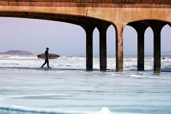 Surfing at Boscombe. Image via Tourism South East