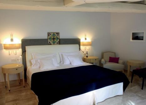 Hotelzimmer mit Mountainbike im Is Arenas Private Golf & Foresterie Boutique Resort