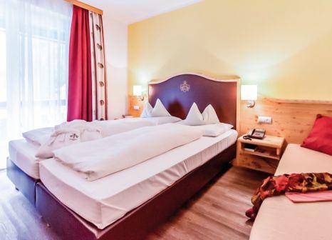 Hotelzimmer mit Mountainbike im Hotel Trattlerhof