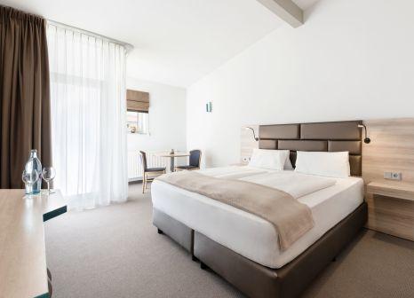 Hotelzimmer mit Mountainbike im Donna Hotel Klosterhof