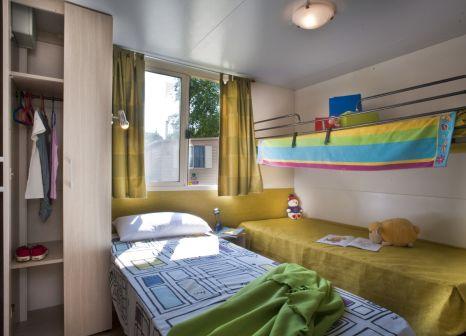 Hotelzimmer mit Mountainbike im Centro Vacanze Pra' delle Torri