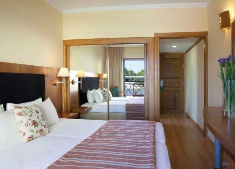 Hotelzimmer mit Mountainbike im Ramada Attica Riviera