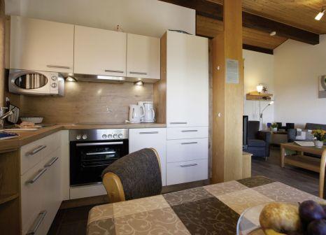 Hotelzimmer mit Mountainbike im Feriendorf Öfingen