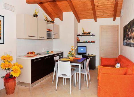 Hotelzimmer mit Mountainbike im Club Village & Hotel Spiaggia Romea