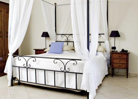 Hotelzimmer mit Mountainbike im Masseria Panareo