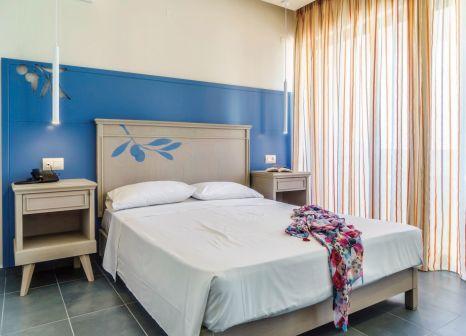 Hotelzimmer mit Mountainbike im Castello Village Resort