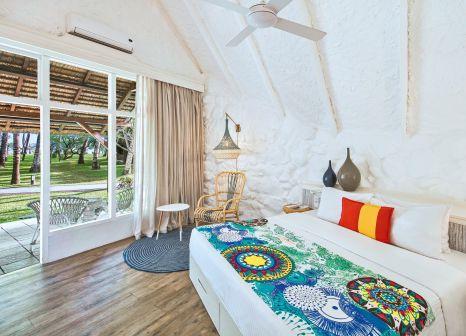 Hotelzimmer mit Yoga im La Pirogue, A Sun Resort
