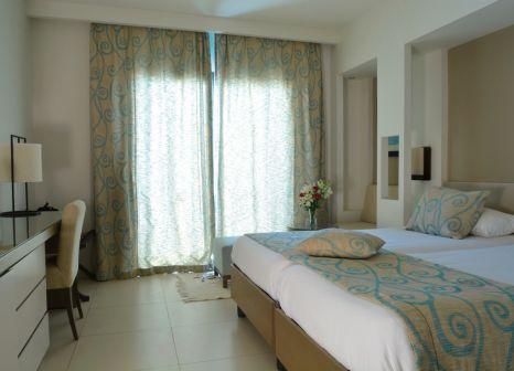 Hotelzimmer mit Mountainbike im SENTIDO Palm Azur