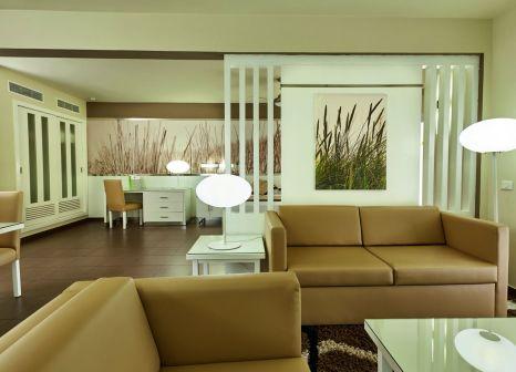Hotelzimmer mit Mountainbike im RIU Yucatan