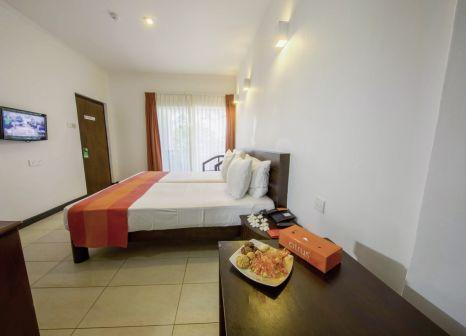 Hotelzimmer mit Mountainbike im Citrus Hikkaduwa