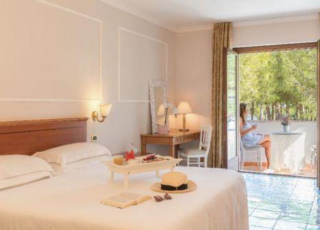 Hotelzimmer mit Mountainbike im Oleandri Resort